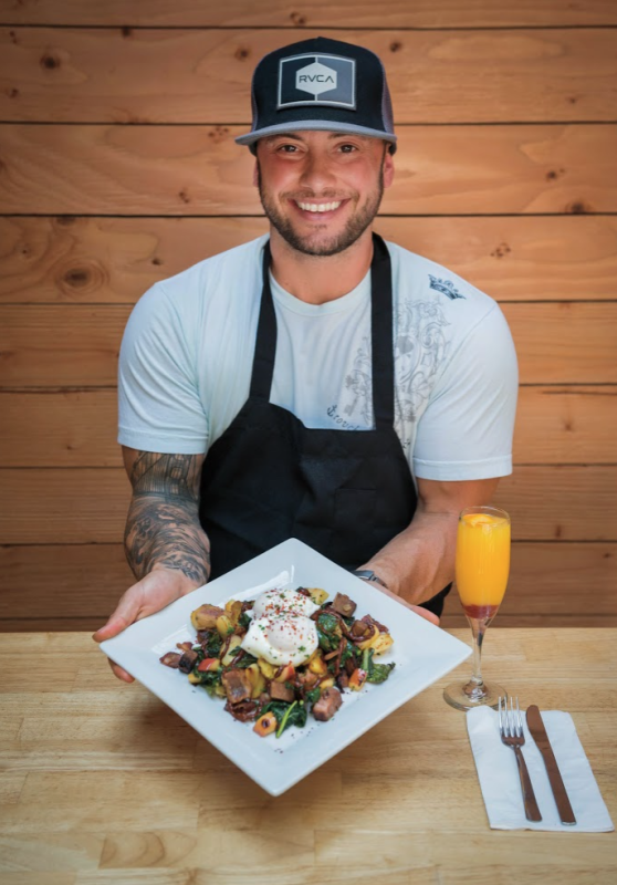 Chef Ty Pearce with Smoked Brisket Hash. Photo: Neil Simmons