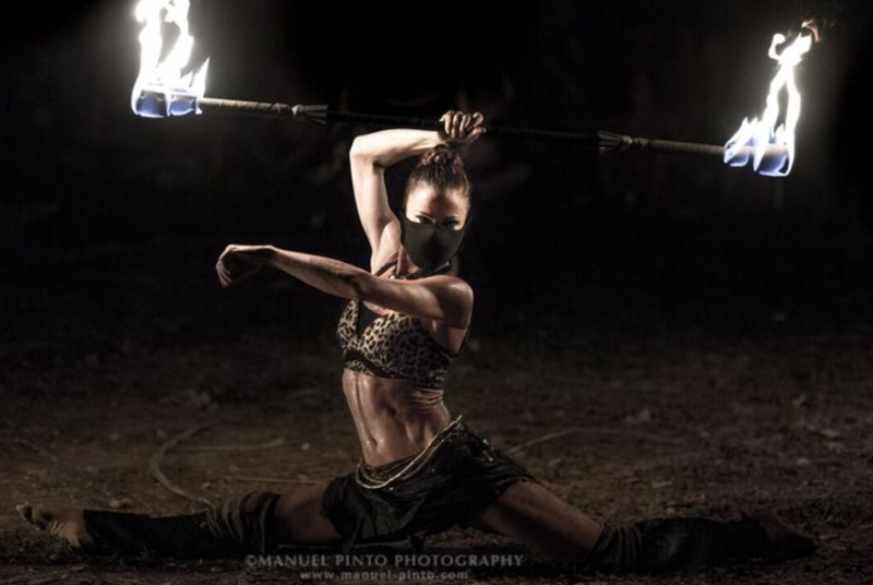 A fire dancer at Envision twirls her flaming staff. Photo courtesy of Manuel Pinto Photography
