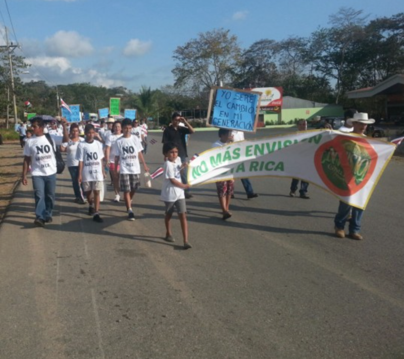 Protestors of Envision march peacefully outside of the festival's gates. Photo courtesy of The Tico Times.