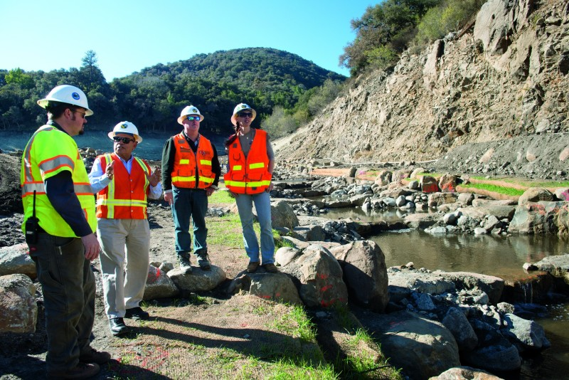 From left, Dylan Wade (engineer for Water Systems Consulting, Inc.), Rashid Ahmad (DWR DSOD retired annuitant), Robert Burns (DWR DSOD engineering geologist), and Kristen Martin (DWR DSOD design engineer) discuss the San Clemente Dam Removal Project and Carmel River Reroute in Carmel Valley, Calif., November 12, 2015.  DWRís Division of Safety of Dams (DSOD) visits the San Clemente Dam removal project site as demolition and construction wraps up in Monterey County. The 106-foot tall arch concrete dam was removed from the Carmel River in August of 2015 to eliminate the seismic safety risk it posed. In addition to DSOD Engineers and Geologists reviewing and approving the demolition plan, they inspected the site to ensure stability of the land surrounding the demolished dam and the two new sediment retention structures. Further restoration work is expected in 2016 by the dam owner. For more information, visit http://www.sanclementedamremoval.org/.   Florence Low / California Department of Water Resources, FOR EDITORIAL USE ONLY