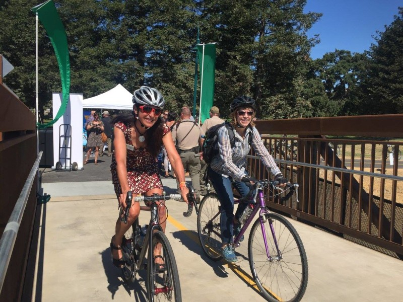 2 on bridge cyclists open