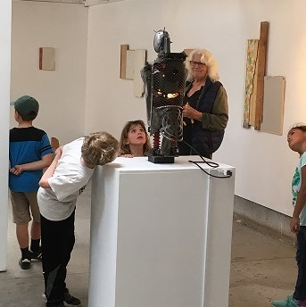 Kids looking at robot